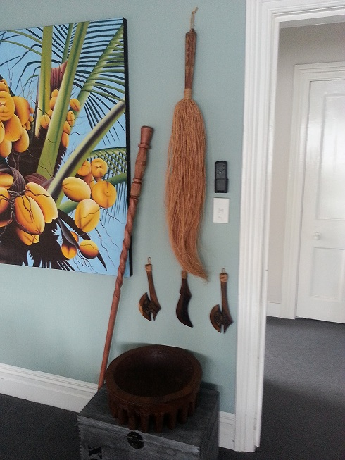 "A recent addition to our living room.  Our ""Samoan Corner"" features a Fue and To'oto'o, used by talking chiefs.  The Kava Bowl is used in Samoan ceremonies accompanied by three carved Naifi (knives/axes)."
