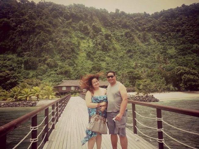 Mister and I at 'Aga Reef Resort.  Breathtaking backdrop of Lalomanu's mountainside.